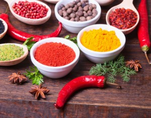 Various kind of spices on wooden background